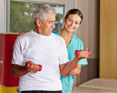 woman hepling senior man to exercise
