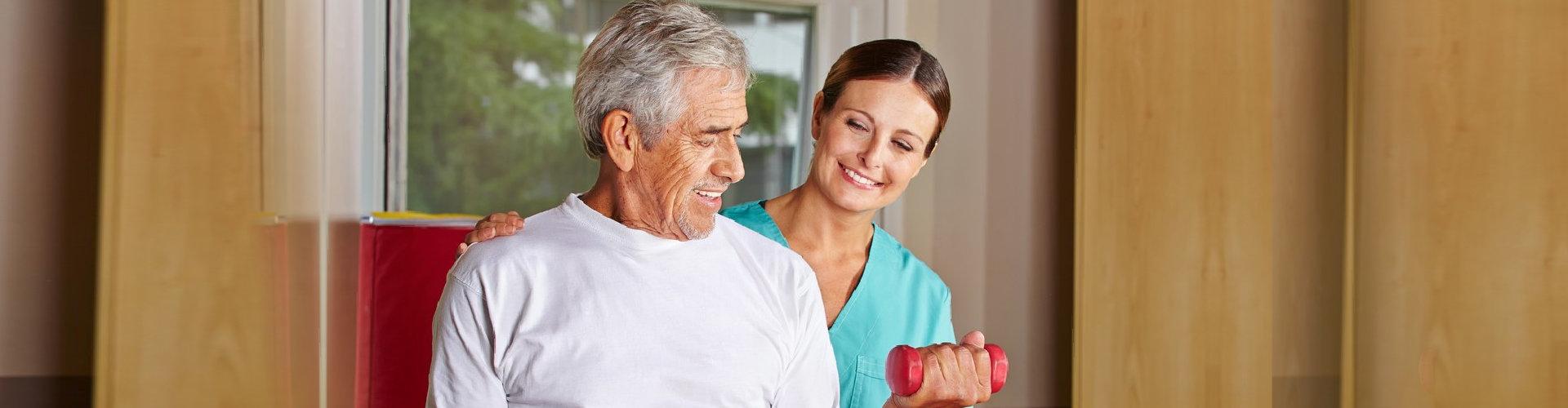 woman hepling senior man to exercise